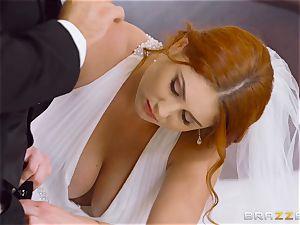 stunning ginger-haired Lennox Luxe plumbed in her wedding sundress